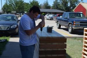 Me building raised garden beds