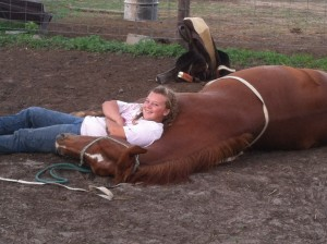 My horse, Redboots, relaxing after I laid her down.