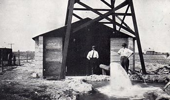 old photo of a well pumping water