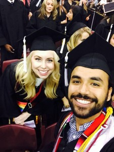My friend Alex and I at graduation as we are waiting to be seated.