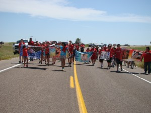 The bikers, runners, and walkers began in Kyle, SD and continued 30 miles to Wanblee, SD. We marched with banners of our loved ones we lost by suicide