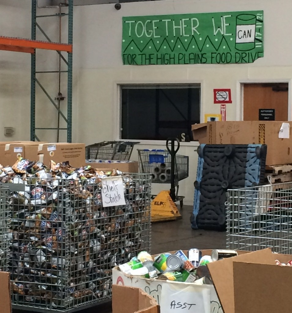 Banner and shelf-stable items in the High Plains Food Bank Warehouse.