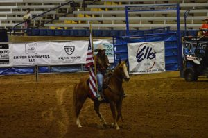 Me carrying the American Flag for the finals this past week.