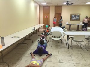 Helping with a game at the Dimmitt Library